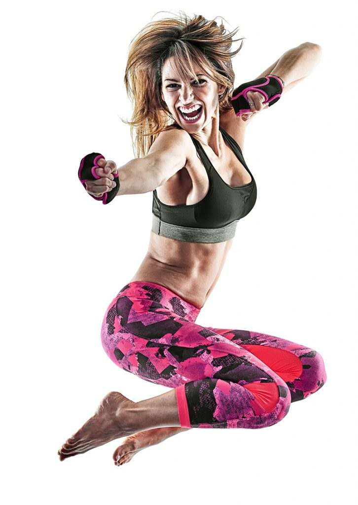 one caucasian woman exercising fitness boxing pilates piloxing excercises in studio isolated on white background